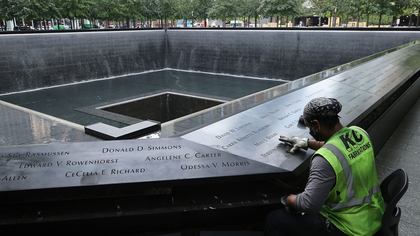 <i>Chip Somodevilla/Getty Images</i><br/>Polishing work is done on the bronze parapets surrounding the twin Memorial pools. A new CNN Poll finds that 57% of Americans say the attacks impacted the way they live their life today.