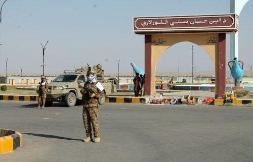 Taliban commando fighters stand guard in Lashkar Gah
