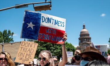 Texas 6-week abortion ban went into effect early Wednesday.  Abortion protesters here hold up signs as they march down Congress Ave outside the Texas state capitol on May 29