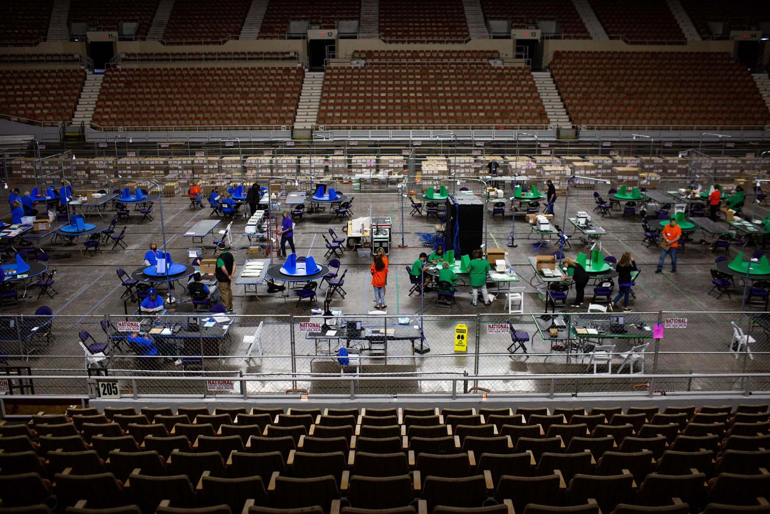 <i>Courtney Pedroza/The Washington Post/Getty Images</i><br/>Cyber Ninjas workers examine and recount ballots from the 2020 general election on May 3