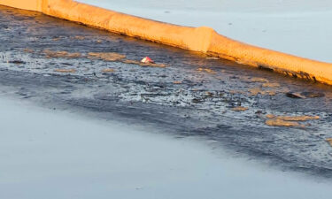 An oil slick stretches from the Huntington Beach Pier to Newport Beach