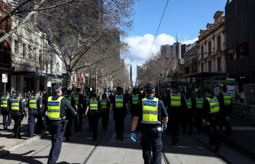 A total of 43 police staff in the Australian state of Victoria have been stood down from duty and could face being fired after they failed to comply with a Covid-19 vaccine mandate. A heavy Victoria Police presence is seen here as anti-lockdown protesters take to the streets on August 21 in Melbourne