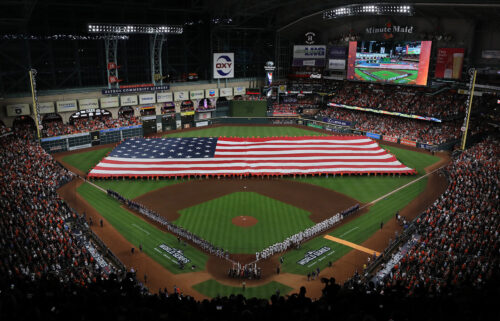 The Astros and Braves line up for the national anthem prior to the first pitch in Houston on October 26.