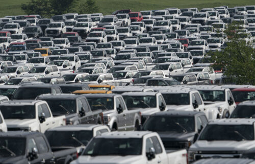 New Ford F-Series pickup trucks are stored in a lot during a semiconductor shortage at Kentucky Speedway in Sparta