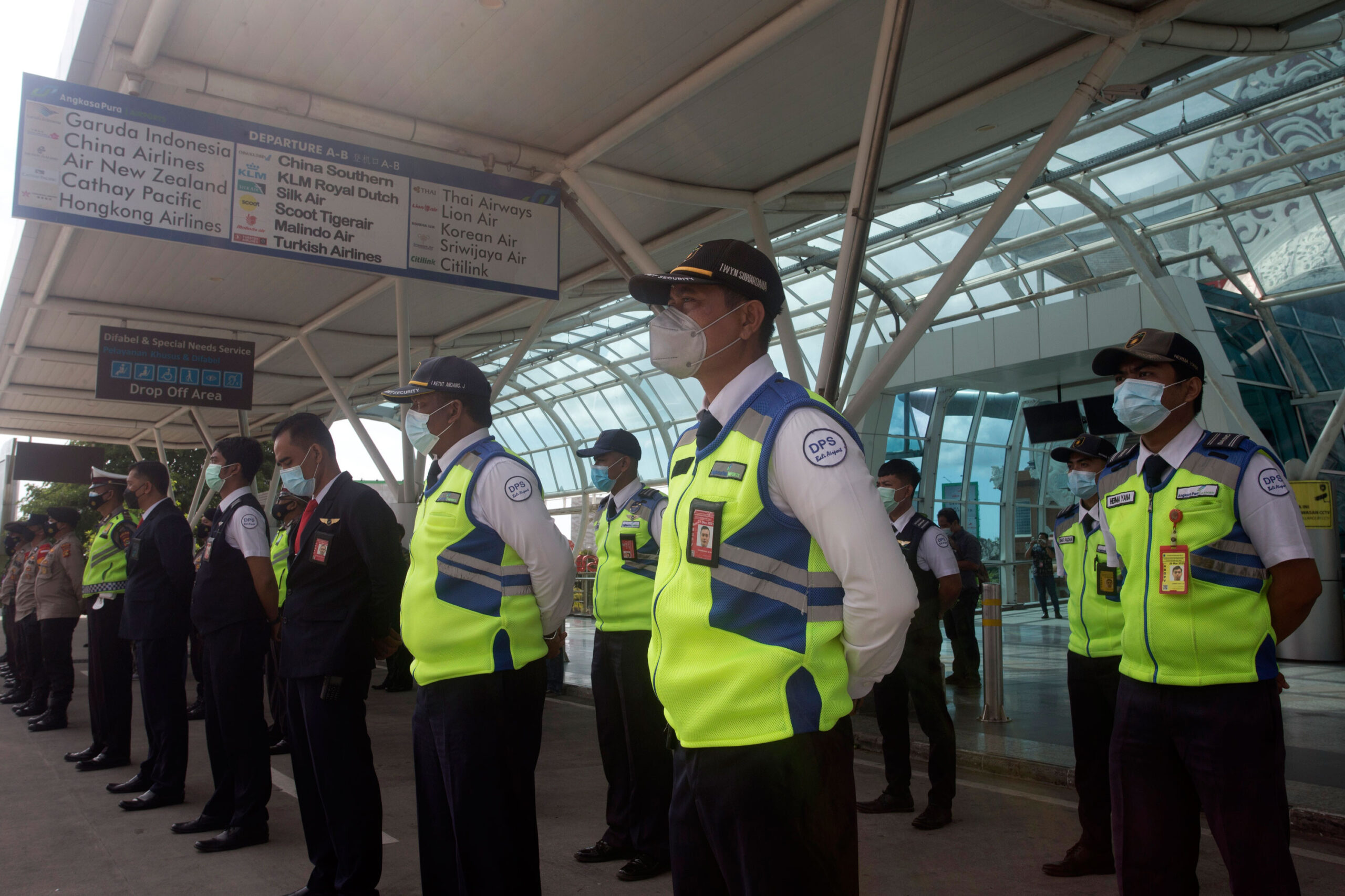 <i>Firdia Lisnawati/AP</i><br/>Indonesia's Bali and Riau Islands are reopening to visitors from 19 countries starting Thursday. Airport security personnel are shown here during a briefing in preparation of the reopening of International Ngurah Rai Airport in Bali