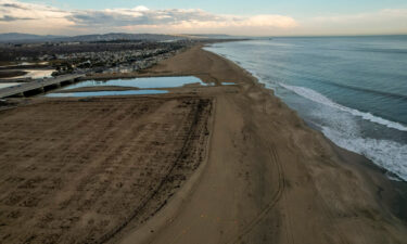 The recently cleaned beach in the affected area of the oil spill off the coast of Huntington Beach